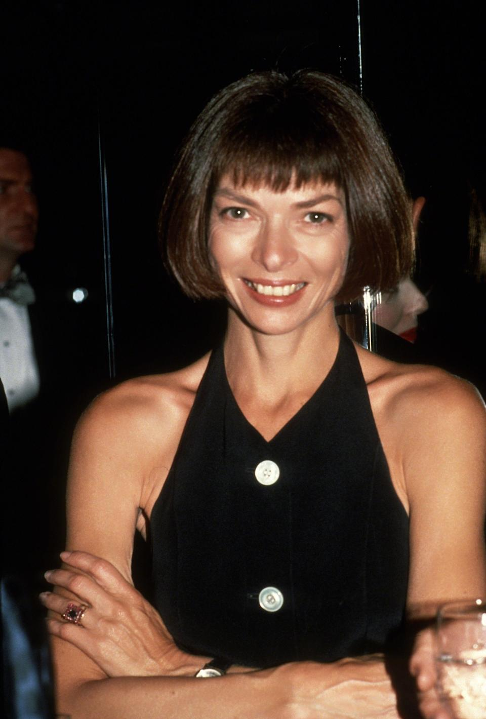 THEN: Statement buttons added a sophisticated touch to Anna Wintour's outfits.
