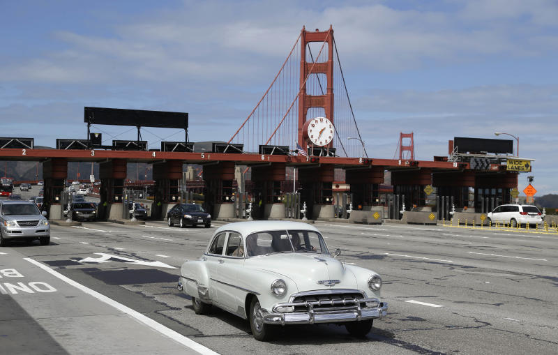 An old Chevrolet makes its way past the toll booths on the Golden Gate Bridge Tuesday, March 26, 2013 in San Francisco. The historic bridge will take a high-tech leap forward when it becomes the first California span to replace all human toll takers with an electronic system that ends the need for motorists to stop and pay cash. Toll takers will collect money for the last time early Wednesday before the toll booths are closed for good. (AP Photo/Eric Risberg)