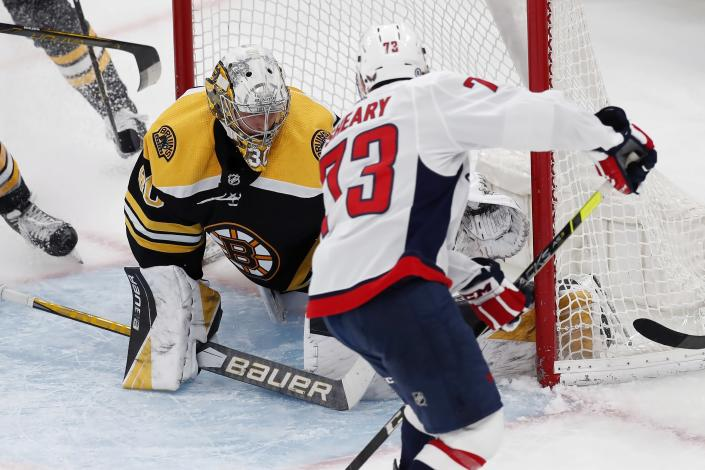 Washington Capitals' Conor Sheary, right, scores on Boston Bruins' Dan Vladar, left, during the second period of an NHL hockey game, Sunday, April 11, 2021, in Boston. (AP Photo/Michael Dwyer)