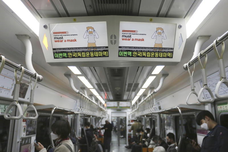 Electric screens about precautions against the COVID-19 illness are seen in a subway train in Seoul, South Korea, Monday, April 6, 2020. The new coronavirus causes mild or moderate symptoms for most people, but for some, especially older adults and people with existing health problems, it can cause more severe illness or death. (AP Photo/Ahn Young-joon)