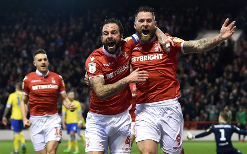 Daryl Murphy (right) was at Nottingham Forest when he received a six-week suspension last season - PA