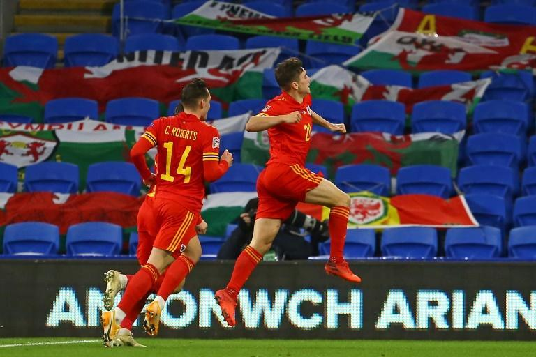 Daniel James celebrates after scoring for Wales as they beat Finland 3-1 to secure promotion to the top tier of the Nations League