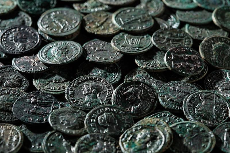 A total of 4,166 Roman coins were unearthed in excellent condition at a farm in Ueken, Switzerland (AFP Photo/)