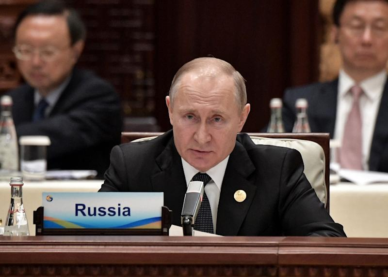 Russia's President Vladimir Putin speaks during a roundtable summit session on the final day of the Belt and Road Forum in Beijing on April 27, 2019