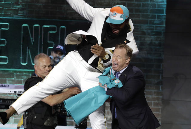FILE - In this April 25, 2019, file photo, Clemson defensive tackle Christian Wilkins moves into NFL Commissioner Roger Goodell after the Miami Dolphins selected Wilkins in the first round at the NFL football draft in Nashville, Tenn. NFL vice president Troy Vincent has sent a letter to several prospects inviting them to participate live in the NFL draft in three weeks. In recent drafts, first-round selections were announced by Commissioner Goodell. Then followed hugs involving players and Goodell some of them comical and photo sessions with the players wearing team ball caps or even showing off team jerseys. This year, with all public events at the planned site of Las Vegas canceled and the draft set to proceed remotely, players will likely be at their homes when their names are called. (AP Photo/Steve Helber, File)