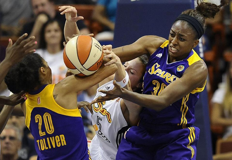 Connecticut Sun's Kelsey Griffin, center, battles for a rebound against Los Angeles Sparks' Kristi Toliver, left, and Nneka Ogwumike, right, during the first half of a WNBA basketball game in Uncasville, Conn., Tuesday, Aug. 6, 2013. (AP Photo/Jessica Hill)