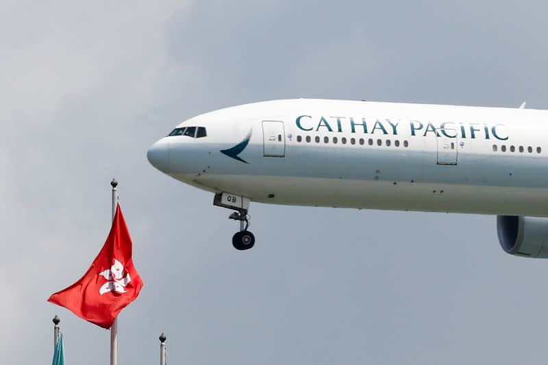 FILE PHOTO: A Cathay Pacific Boeing 777 plane lands at Hong Kong airport