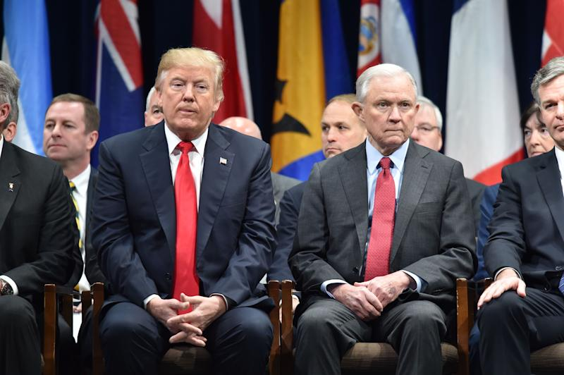 US President Donald Trump(L)sits with Attorney General Jeff Sessions on December 15, 2017 in Quantico, Virginia, before participating in the FBI National Academy graduation ceremony.(NICHOLAS KAMM/AFP/Getty Images)
