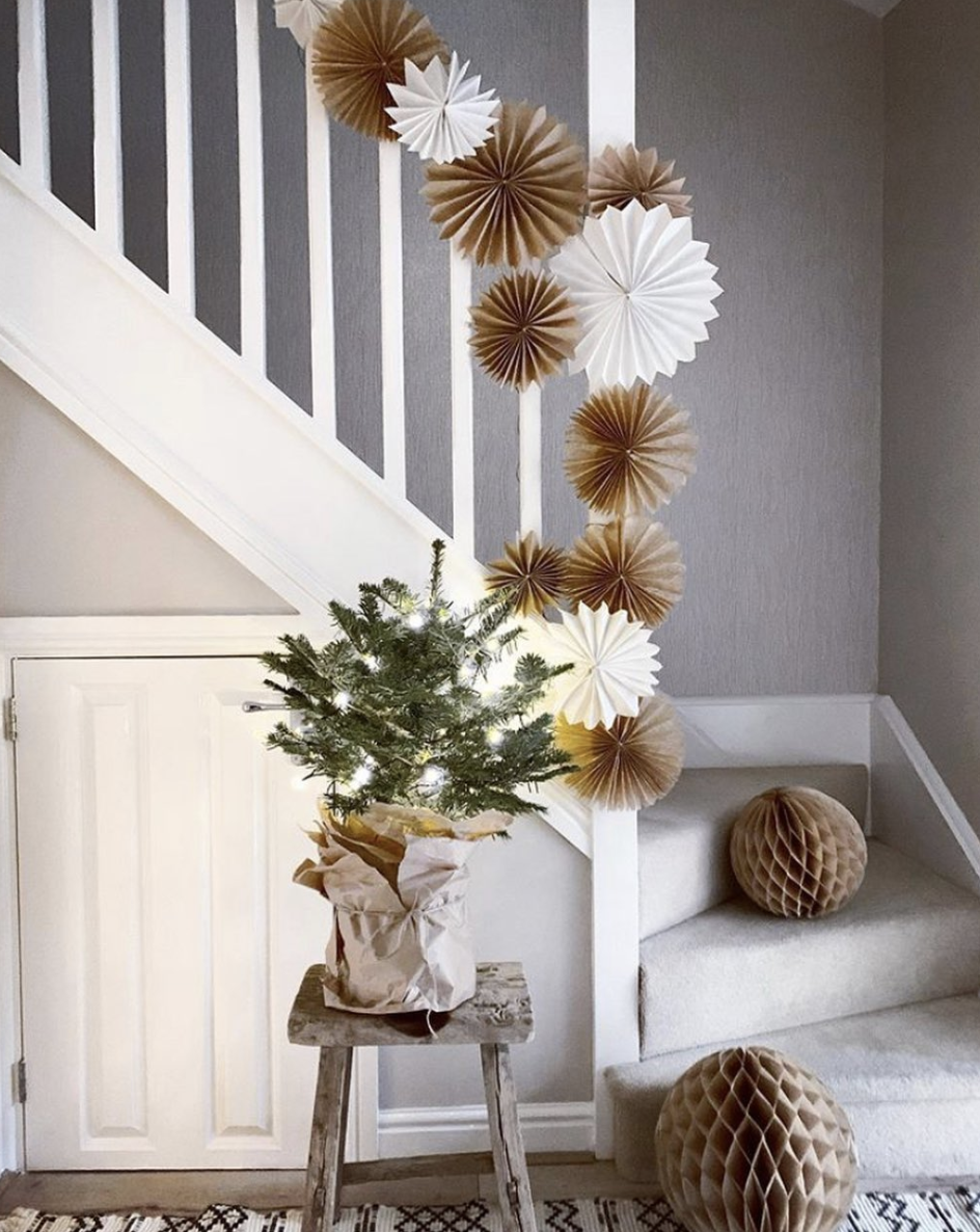 """<p>Go a more whimsical—but just as holiday-appropriate—route with gold and white paper fans and honeycomb balls. It's an excellent cost-saver, since you can repurpose these items as party decor year-round. </p><p><em>See more at <a href=""""https://www.instagram.com/p/B6ktxcNnJNb/"""" rel=""""nofollow noopener"""" target=""""_blank"""" data-ylk=""""slk:love_nordic_x"""" class=""""link rapid-noclick-resp"""">love_nordic_x</a>. </em></p><p><a class=""""link rapid-noclick-resp"""" href=""""https://www.amazon.com/Decoration-Garlands-Graduation-Accessories-Luckystar/dp/B07GHZ568Y?tag=syn-yahoo-20&ascsubtag=%5Bartid%7C10072.g.34479907%5Bsrc%7Cyahoo-us"""" rel=""""nofollow noopener"""" target=""""_blank"""" data-ylk=""""slk:SHOP PAPER FANS"""">SHOP PAPER FANS</a></p>"""