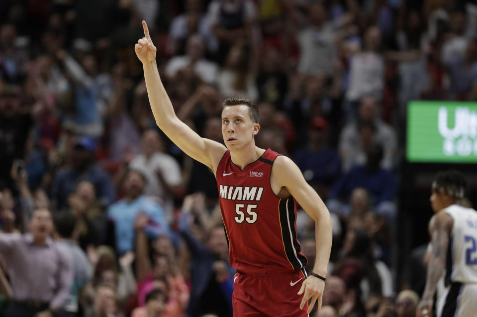Miami Heat forward Duncan Robinson celebrates after scoring during the second half of the team's NBA basketball game against the Orlando Magic, Wednesday, March 4, 2020, in Miami. (AP Photo/Wilfredo Lee)