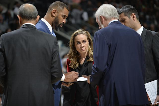 "Becky Hammon (center) has been a member of Gregg Popovich's staff with the <a class=""link rapid-noclick-resp"" href=""/nba/teams/sas"" data-ylk=""slk:San Antonio Spurs"">San Antonio Spurs</a> since the summer of 2014. (Getty)"