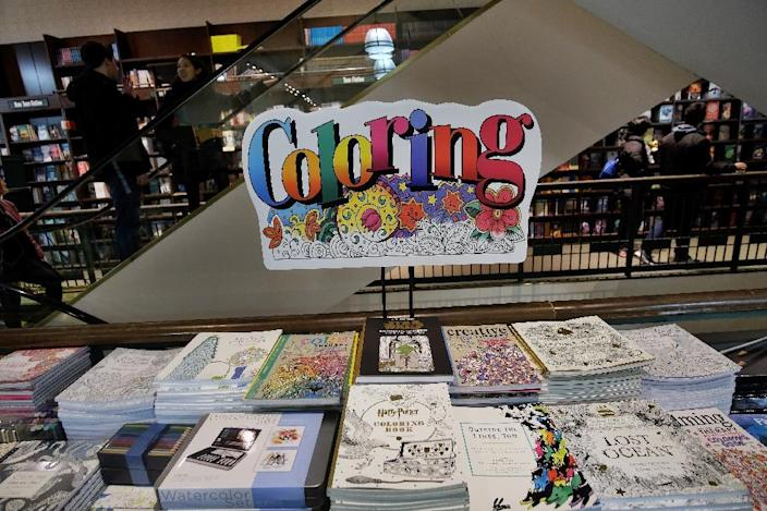 "The latest lifestyle craze, adult coloring books, lets buyers choose from Sanskrit patterns, urban landscapes, butterflies and flowers all offering ""stress relieving patterns"" (AFP Photo/Jewel Samad)"