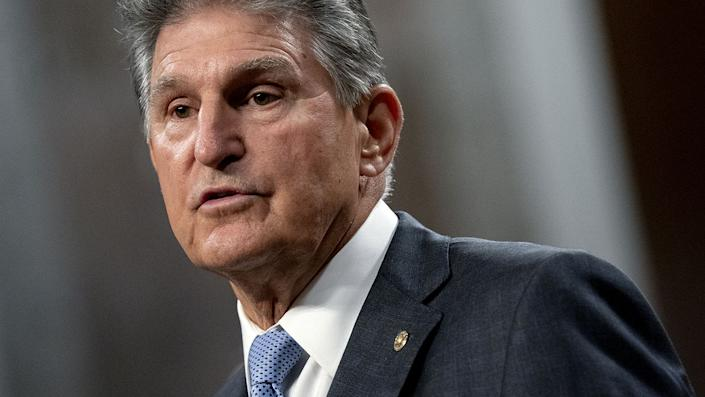 Senator Joe Manchin, a Democrat from West Virginia, speaks during a news conference in the Dirksen Senate Office Building in Washington, D.C., U.S., on Wednesday, July 28, 2021. A bipartisan group of senators and the White House reached a tentative agreement on a $550 billion infrastructure package, a significant breakthrough in the drive to muscle through Congress a massive infusion of spending for roads, bridges and other critical projects. Photographer: Stefani Reynolds/Bloomberg via Getty Images