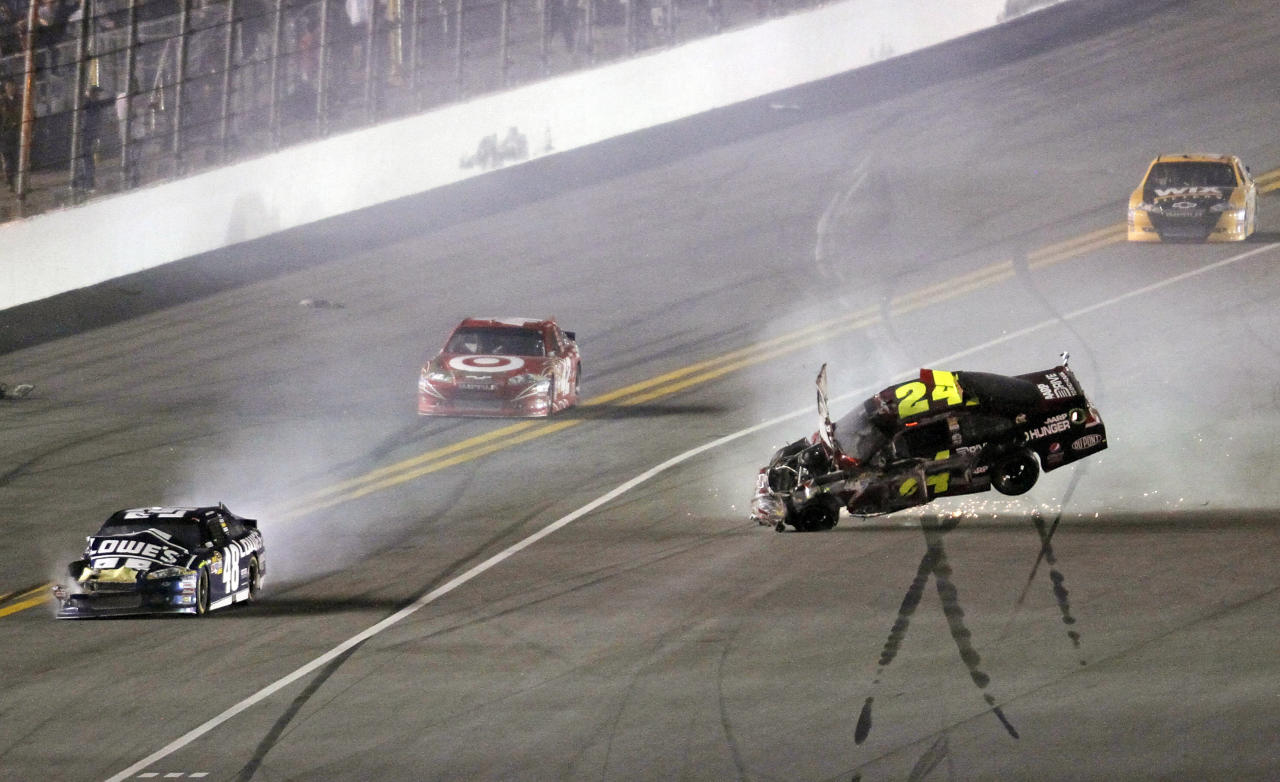 Jeff Gordon's car (24) flips after he was involved in a wreck with several other cars, including Jimmie Johnson (48), as Juan Pablo Montoya, second from left, and Ryan Newman make moves to avoid them during the NASCAR Budweiser Shootout auto race at Daytona International Speedway, Saturday, Feb. 18, 2012, in Daytona Beach, Fla. (AP Photo/David Graham)