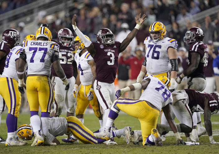 Texas A&M defensive lineman Tyree Johnson (3) celebrates after sacking LSU quarterback Joe Burrow during the second half of an NCAA college football game Saturday, Nov. 24, 2018, in College Station, Texas. Texas A&M won 74-72 in seven overtimes. (AP Photo/David J. Phillip)