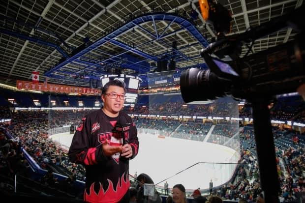 Brian Wong works part-time for the Calgary Flames, producing digital content in a mixture of English and Cantonese. He also talks hockey in Chinese on his popular podcasts. (Submitted by Brian Wong - image credit)