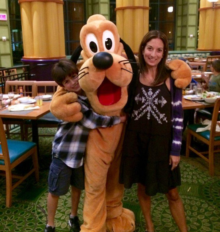 Pluto gets some love from visitors at the Garden Grove. (Miriam Porter)