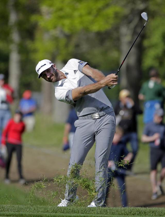 Dustin Johnson hits off the 13th fairway during the first round of the PGA Championship golf tournament, Thursday, May 16, 2019, at Bethpage Black in Farmingdale, N.Y. (AP Photo/Seth Wenig)