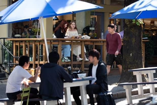 People dine in downtown Vancouver on Sept. 7. As of Sept. 13, anyone who wants to eat at a restaurant in British Columbia will need to prove they are vaccinated. (CBC - image credit)