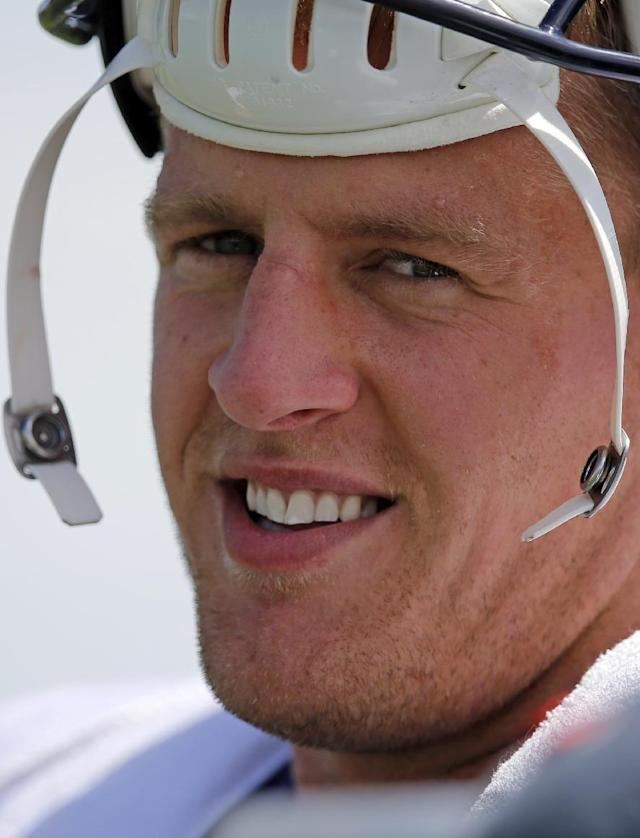 Houston Texans defensive end J.J. Watt smiles following a joint practice between the Denver Broncos and Texans on Tuesday, Aug. 19, 2014, in Englewood, Colo. (AP Photo/Jack Dempsey)
