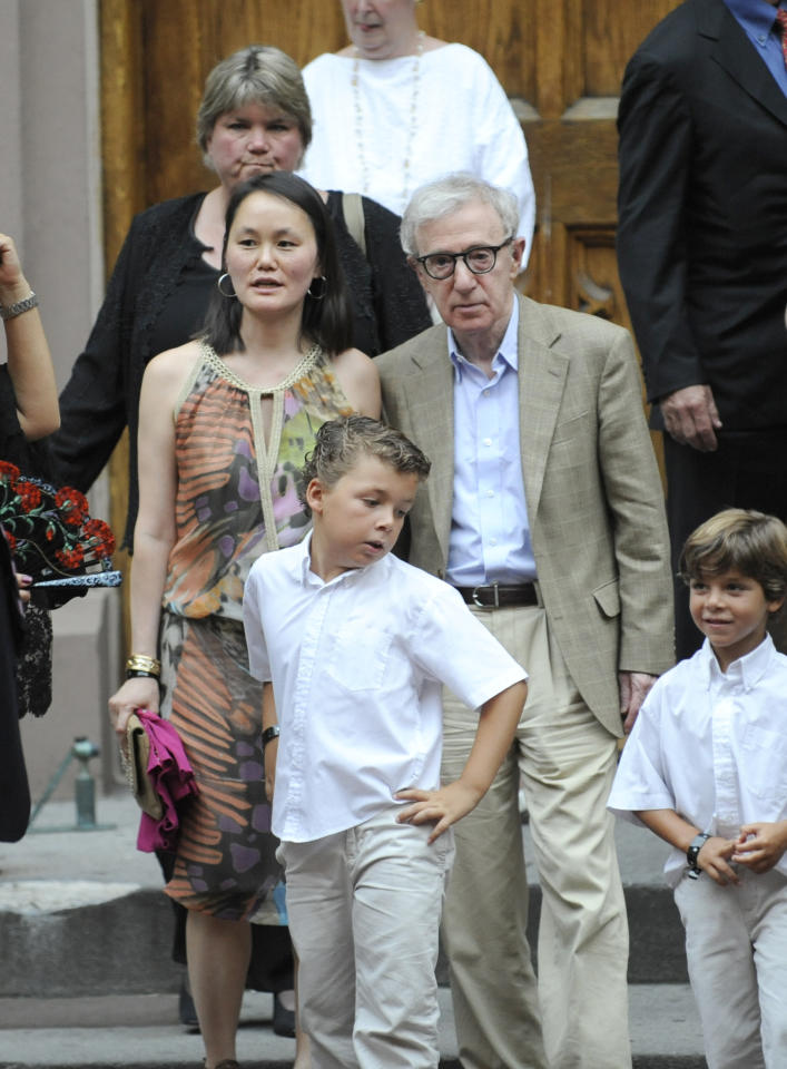 Woody Allen and Soon Yi exit St. Patrick's Old Cathedral after the wedding of Alec Baldwin and Hilaria Thomas in New York on Saturday, June 30, 2012. (AP Photo/Louis Lanzano)