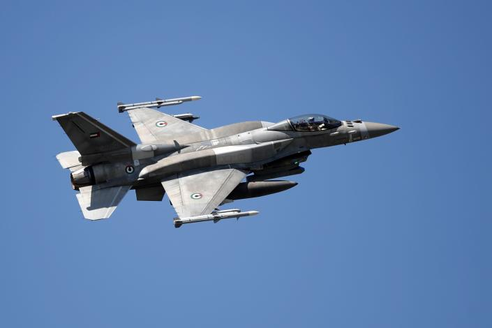 A United Arab Emirates fighter jet F16 flies during the international military exercise Iniochos at Andravida air base, about 279 kilometres (174 miles) southwest of Athens, Tuesday, April 20, 2021. Greece vowed Tuesday to expand military cooperation with traditional NATO allies as well as Middle Eastern powers in a race to modernize its armed forces and face its militarily assertive neighbor Turkey. (AP Photo/Thanassis Stavrakis)