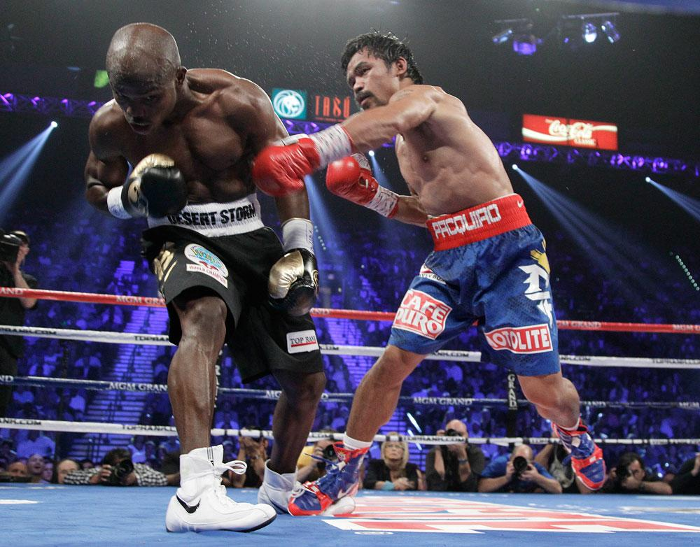 Manny Pacquiao, from the Philippines, right, connects with a punch against Timothy Bradley, from Palm Springs, Calif., in the third round of their WBO welterweight title fight Saturday, June 9, 2012, in Las Vegas.