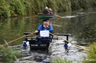 "80-year old military veteran Stanley rows homemade boat named the ""Tintanic"" to raise funds for charity St Wilfrid's Hospice, in Chichester"