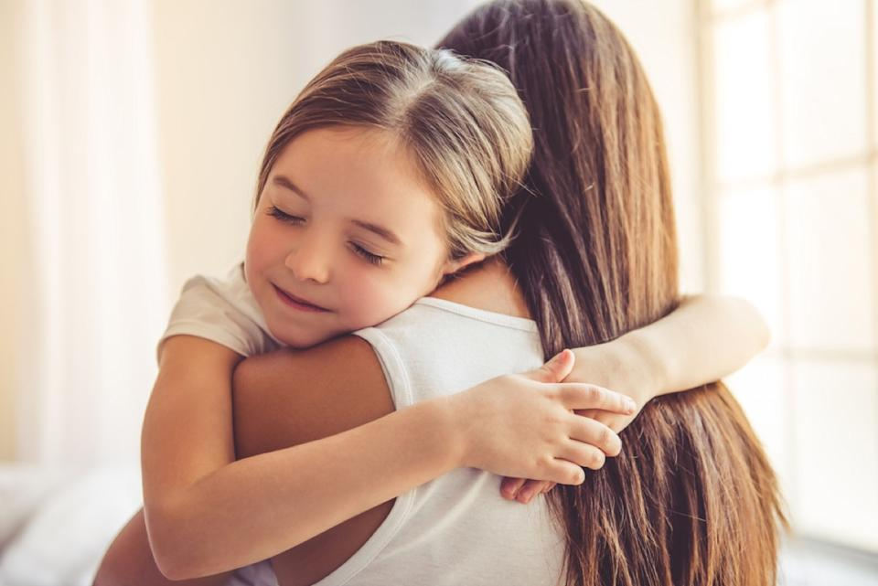 young girl hugging her mother, over 50 regrets