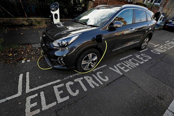 PHOTO: An electric car charges on a street recharging port in London, Nov. 18, 2020. (Kirsty Wigglesworth/AP)