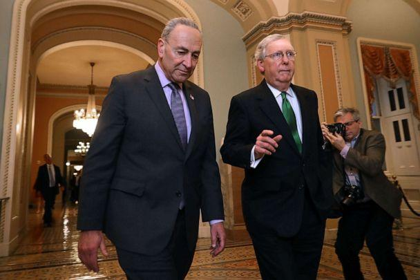 PHOTO: Senate Minority Leader Charles Schumer and Senate Majority Leader Mitch McConnell walk side-by-side to the Senate Chamber at the U.S. Capitol Feb. 7, 2018, in Washington. (Chip Somodevilla/Getty Images, FILE)