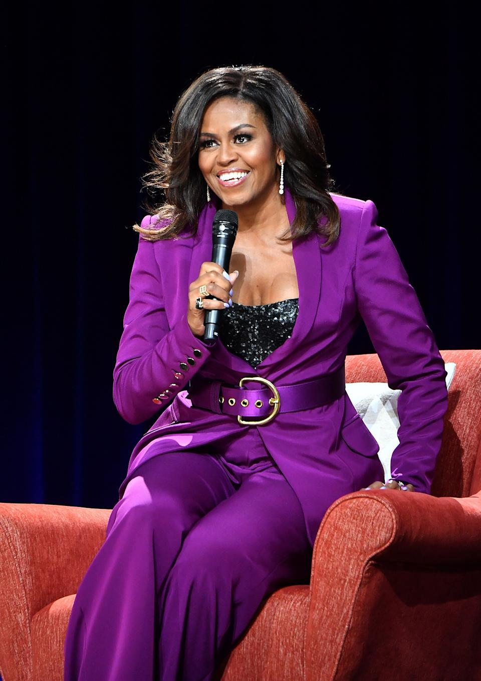 """Obama headlines a book tour stop, """"Becoming: An Intimate Conversation with Michelle Obama,"""" at the State Farm Arena on May 11 in Atlanta. (Photo: Paras Griffin via Getty Images)"""