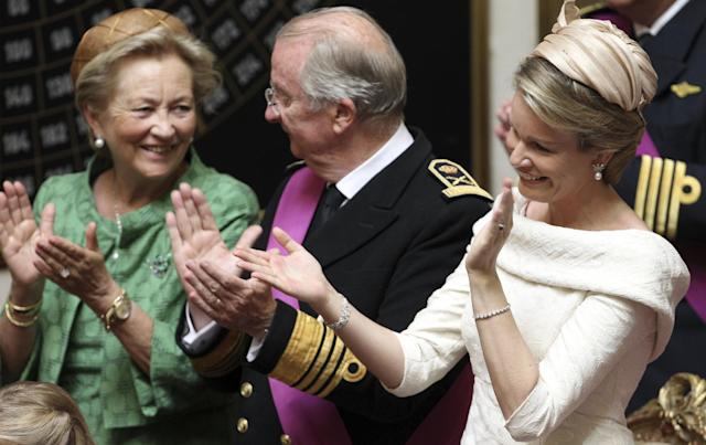 From left, Belgium's Queen Paola, King Albert II and Princess Mathilde applaud after the speech of Belgium's Prince Philippe at the Palace of the Nation in Brussels on Sunday, July 21, 2013. Philippe has taken the oath before parliament to become Belgium's seventh king after his father Albert II abdicated as the head of this fractured nation. Earlier Sunday, the 79-year-old Albert signed away his rights as the kingdom's largely ceremonial ruler at the royal palace in the presence of Prime Minister Elio Di Rupo, who holds the political power in this 183-year-old parliamentary democracy. (AP Photo/Yves Logghe)