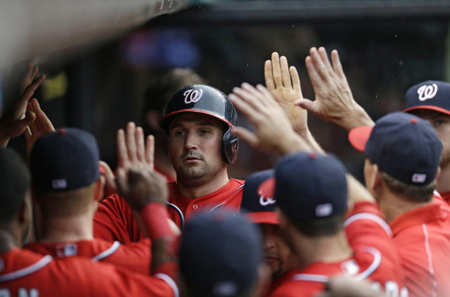 Washington Nationals' Ryan Zimmerman is congratulated by teammates after scoring on a wild pitch by Cleveland Indians starting pitcher Scott Kazmir in the third inning of a baseball game, Saturday, June 15, 2013, in Cleveland. (AP Photo/Tony Dejak)