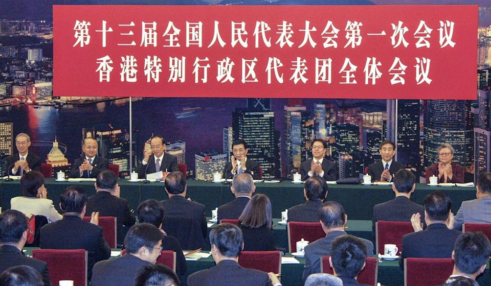 Then-liaison office legal chief Wang Zhenmin (third left) meets members of the Basic Law Committee and National People's Congress in 2018. Photo: Tong Cheung