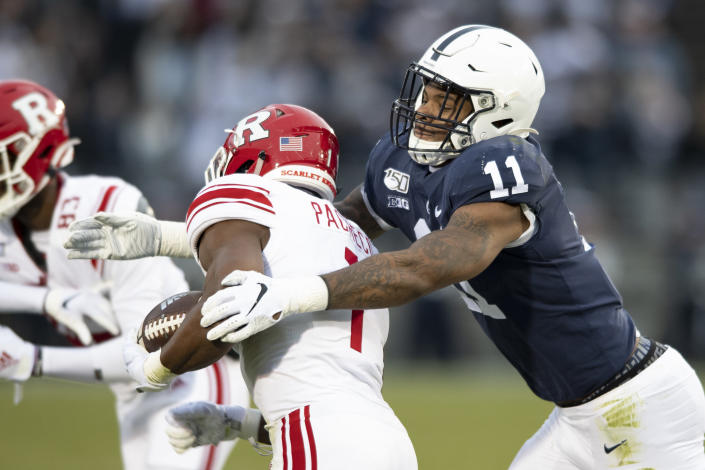FILE - In this Nov. 30, 2019, file photo, Penn State linebacker Micah Parsons (11) tackles Rutgers tight end Johnathan Lewis (11) in the first quarter of an NCAA college football game, in State College, Pa. Andre Odom joined Athletes First as an agent two years ago and later this month two of his clients — Kyle Pitts and Micah Parsons — could be picked in the top 10 of the NFL draft. (AP Photo/Barry Reeger, File)