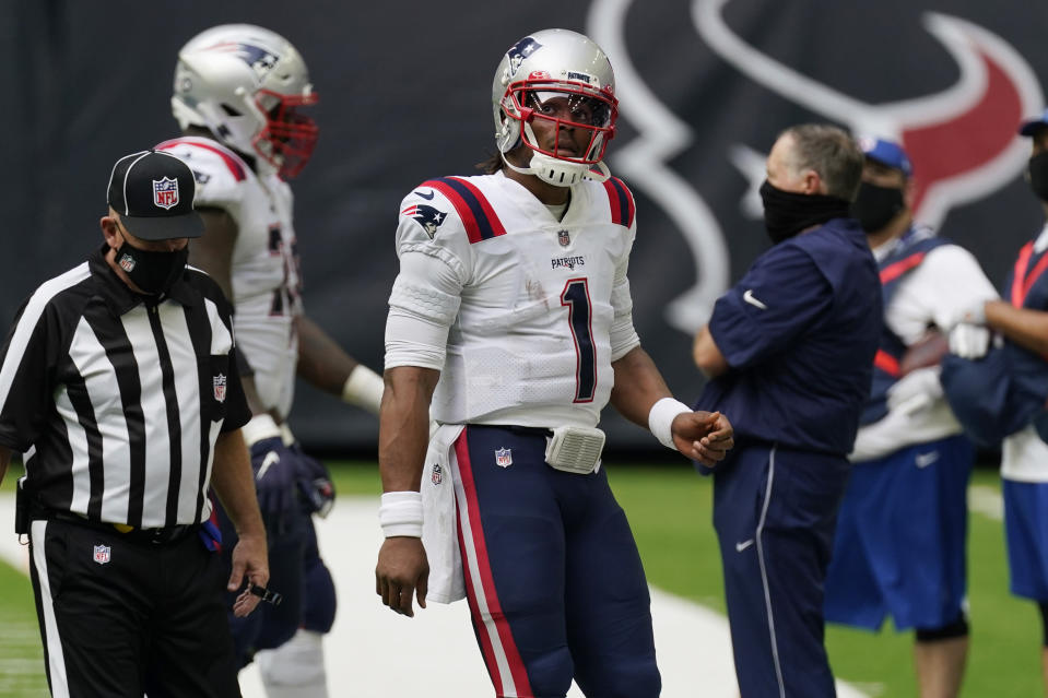 New England Patriots quarterback Cam Newton (1) walks off the field after failing to make first down against the Houston Texans during the second half of an NFL football game, Sunday, Nov. 22, 2020, in Houston. (AP Photo/David J. Phillip)