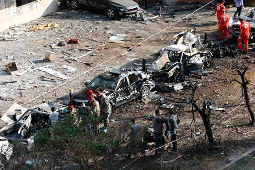 Rescuers and military policemen work on the site of a double suicide bombing outside Iran's embassy in Beirut on November 19, 2013
