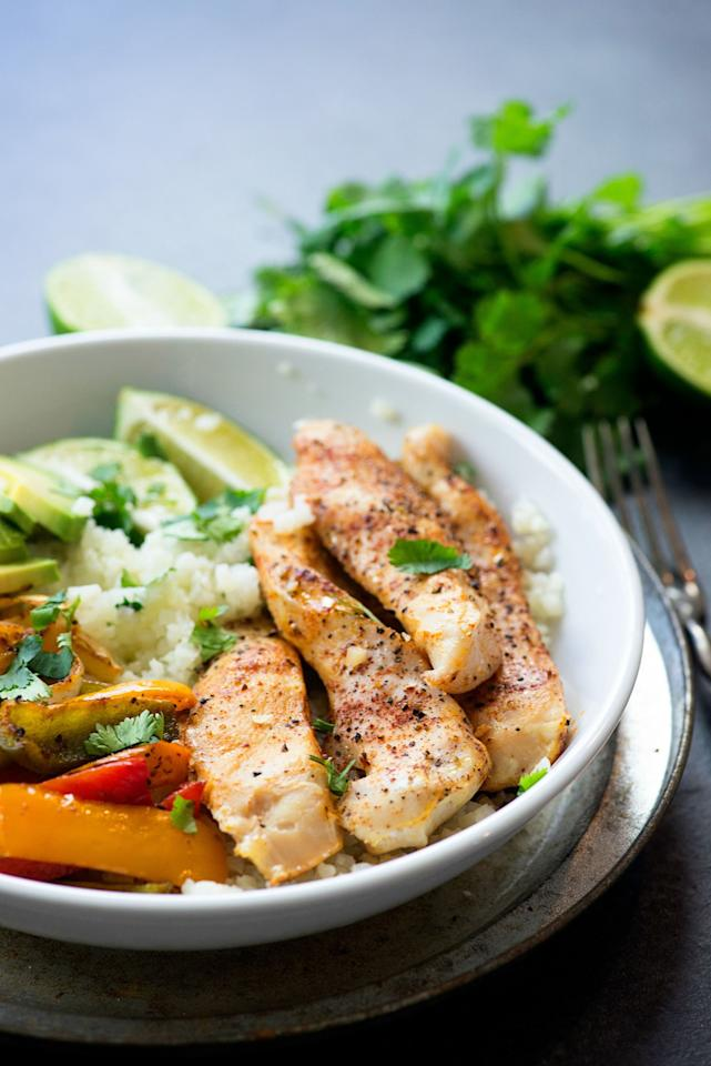 """<p>Because a diet without Mexican food is one we can't stick to.</p><p>Get the recipe from <a rel=""""nofollow"""" href=""""http://www.delish.com/cooking/recipe-ideas/recipes/a52149/chicken-fajita-cauliflower-rice-bowls-recipe/"""">Delish</a>.</p>"""