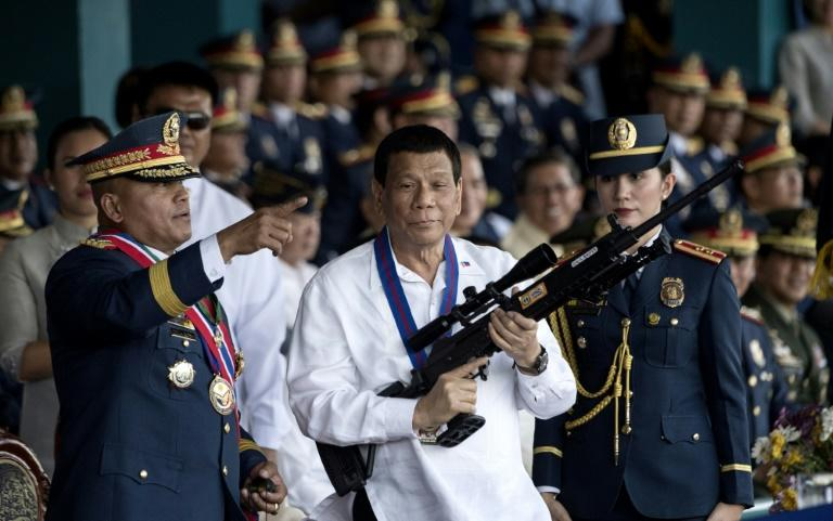 Duterte had created 'a culture of impunity and fear', the report said (AFP Photo/NOEL CELIS)