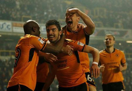 Soccer Football - Championship - Wolverhampton Wanderers vs Derby County - Molineux Stadium, Wolverhampton, Britain - April 11, 2018 Wolves' Ruben Neves celebrates with Conor Coady and Benik Afobe after scoring their second goal Action Images/Andrew Boyers