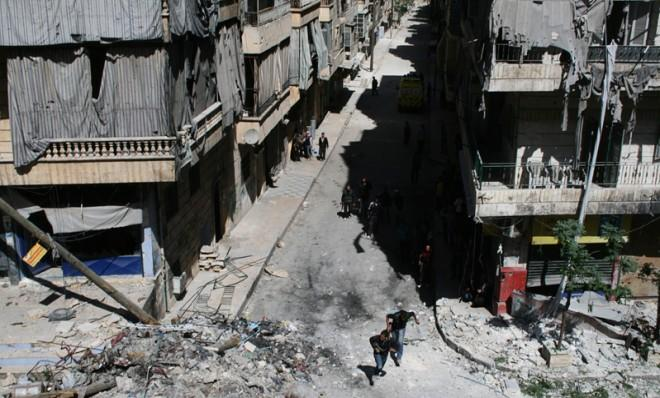 Free Syrian Army fighters run to avoid snipers, April 28.