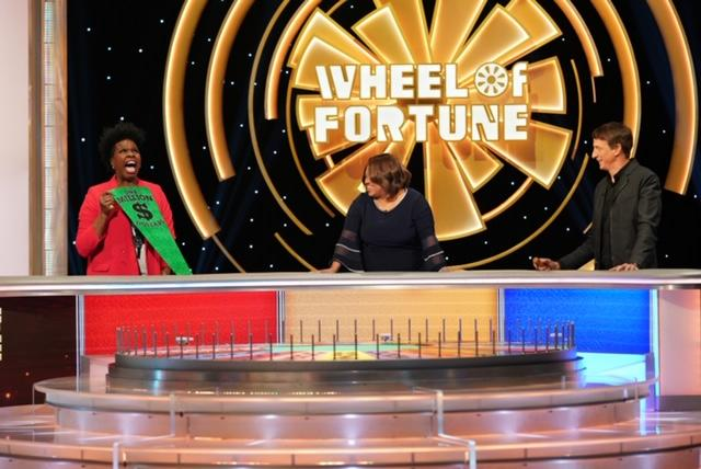"Leslie Jones plays the celebrity edition of ""Wheel of Fortune"" with Chandra Wilson and Tony Hawk. (Photo: ABC/Christopher Willard)"