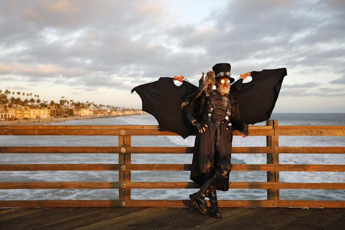 "Dean LeCrone dressed as Dr. Artemus Peepers, a steampunk hero, at the Oceanside Pier. This would have been his 30th year attending Comic-Con. LeCrone, a cartoonist, said his favorite year was 2016, when he won the Syfy Channel's Weirdly Awesome Costume Contest. <span class=""copyright"">(K.C. Alfred / The San Diego Union-Tribune)</span>"