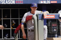 Milwaukee Brewers manager Craig Counsell (30) watches play in the second inning of Game 3 of a baseball National League Division Series against the Atlanta Braves, Monday, Oct. 11, 2021, in Atlanta. (AP Photo/John Bazemore)