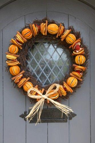 """<p>For the perfect Christmassy statement and scent why not create a wreath out of dried oranges and cinnamon sticks. <a rel=""""nofollow"""" href=""""http://delivermeachristmastree.co.uk/products/184423--real-handmade-christmas-door-wreath-willow-apple-orange-cinnamon.aspx""""><em>[Photo: Deliver me a christmas tree]</em></a> </p>"""