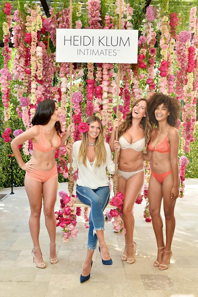 """Heidi Klum flanked by models at a""""bra brunch"""" launching her latestHeidi Klum Intimates campaign at in L.A. on Aug. 17. (Photo: Getty Images)"""