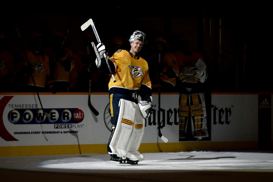 Nashville Predators goaltender Pekka Rinne (35) waves to the crowd during a standing ovation after the Predators defeated the Carolina Hurricanes in an NHL hockey game Monday, May 10, 2021, in Nashville, Tenn.(AP Photo/Mark Zaleski)