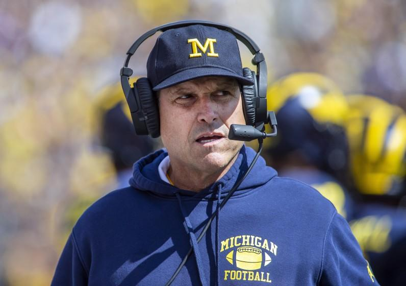FILE - This Sept. 7, 2019, file photo, Michigan head coach Jim Harbaugh watches from the sideline.