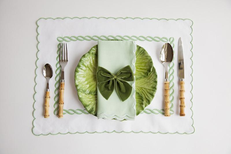 Alice Naylor-Leyland cabbage plate ($45), napkin & placemat ($30), four-piece cutlery set ($90), and napkin ring bow ($7). alicenaylorleyland.com